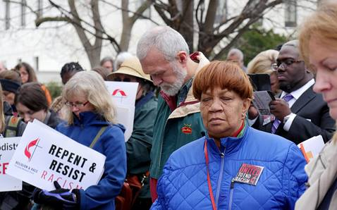 United Methodists pray before a national rally in Washington to end racism in 2018. File photo by Kathy L. Gilbert, UM News.
