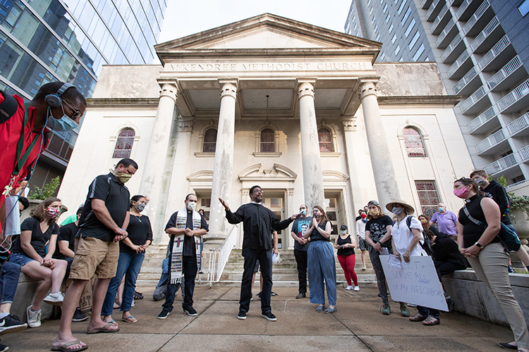 Clergy members lead a prayer during a June 4, 2020, vigil at McKendree United Methodist Church in Nashville, Tenn., to grieve and remember people lost to acts of racism. Photo by Mike DuBose, UM News.