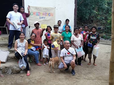 Karl Wesley E. Dillozon (far left) takes group photo some of the clinics patients.