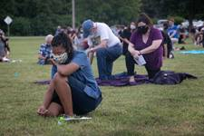 "Maya Cunningham (front), age 16, and others  kneel in silence for 8 minutes in honor of George Floyd during ""A Prayer Service To Stand Against Racism"" held June 5, 2020 at Belle Meade United Methodist Church in Nashville, Tenn. The ecumenical service invited area churches to participate. Cunningham is from First United Pentecostal in Nashville. Photo by Kathleen Barry, UM News."