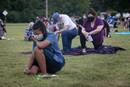 """Maya Cunningham (front), age 16, and others  kneel in silence for 8 minutes in honor of George Floyd during """"A Prayer Service To Stand Against Racism"""" held June 5, 2020 at Belle Meade United Methodist Church in Nashville, Tenn. The ecumenical service invited area churches to participate. Cunningham is from First United Pentecostal in Nashville. Photo by Kathleen Barry, UM News."""