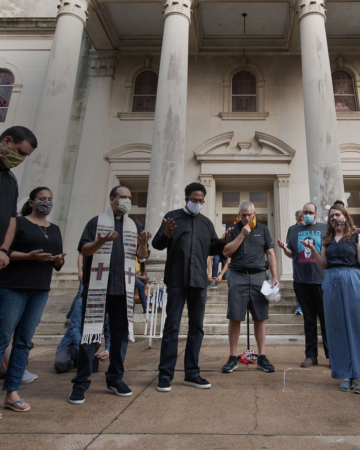 Clergy members gather in prayer during a vigil at McKendree United Methodist Church in Nashville, Tenn., to grieve and remember people lost to acts of racism. Photo by Mike DuBose, UM News.