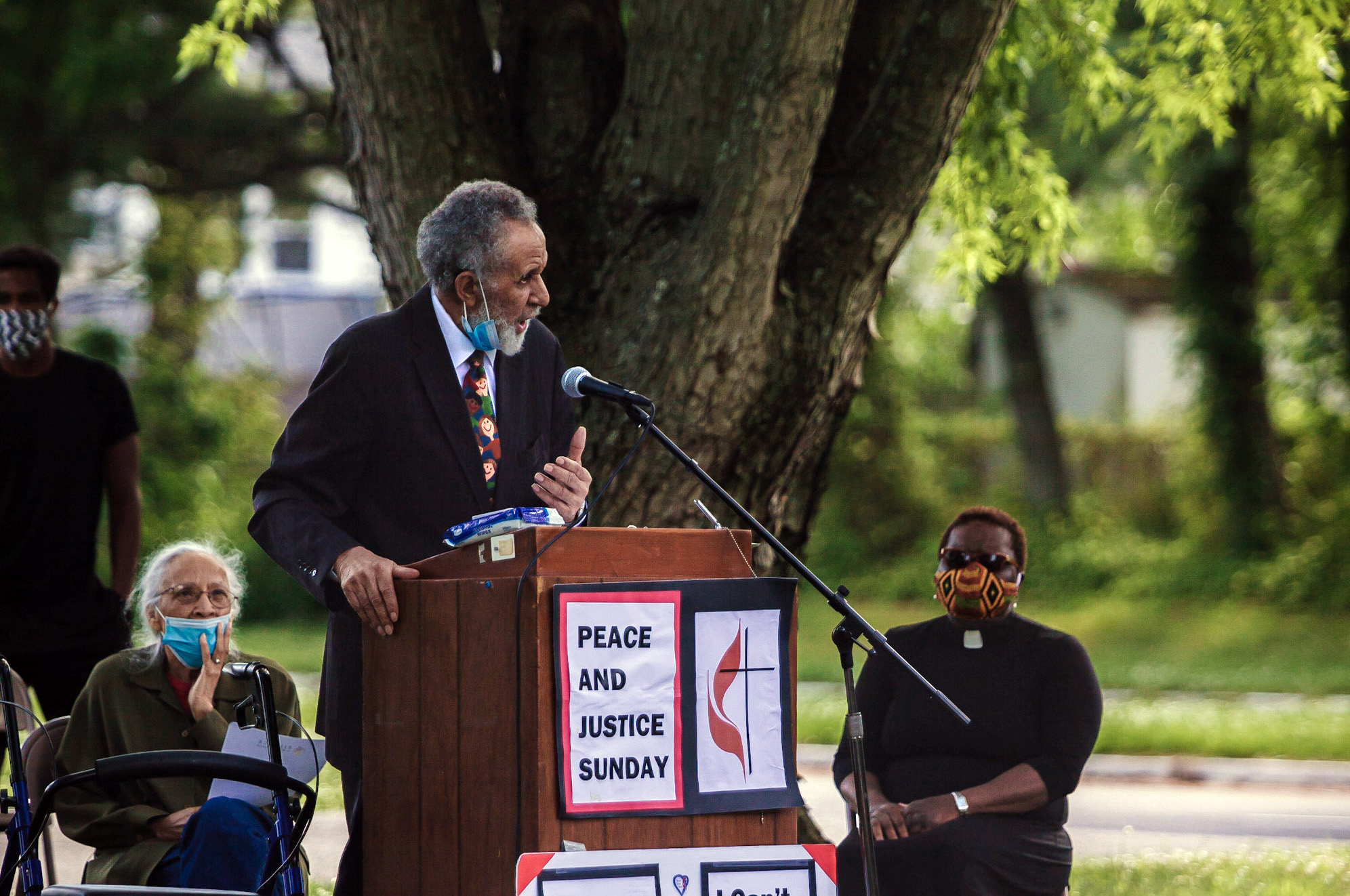 The Rev. Gilbert Caldwell, a retired United Methodist pastor and civil rights activist who marched alongside the Rev. Martin Luther King Jr., speaks during a Black Lives Matter rally June 7 in Willingboro, N.J. To Caldwell's right is his wife, Grace Caldwell. To Caldwell's left is the Rev. Vanessa Wilson, chairperson of the Greater New Jersey Commission on Race and Religion and pastor of Good Shepherd United Methodist Church in Willingboro. The protest was one of many taking place in the U.S. in smaller cities and towns involving United Methodists. Photo by Aaron Wilson Watson