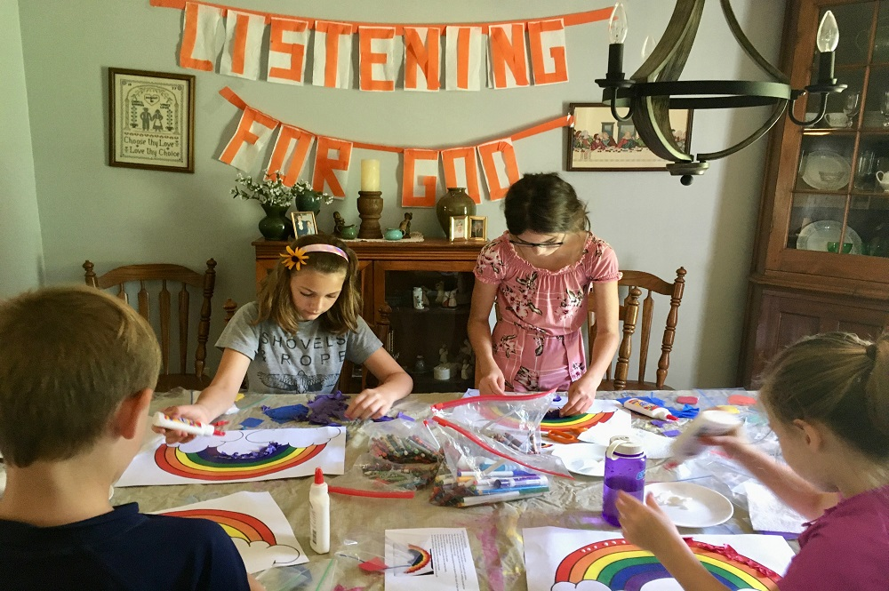 Once at home, families enjoy activities from the VBS packets. Pictured: Four siblings from the Rongitsch family participate in VBS arts and crafts. Photo courtesy of Cheryl Lowe.