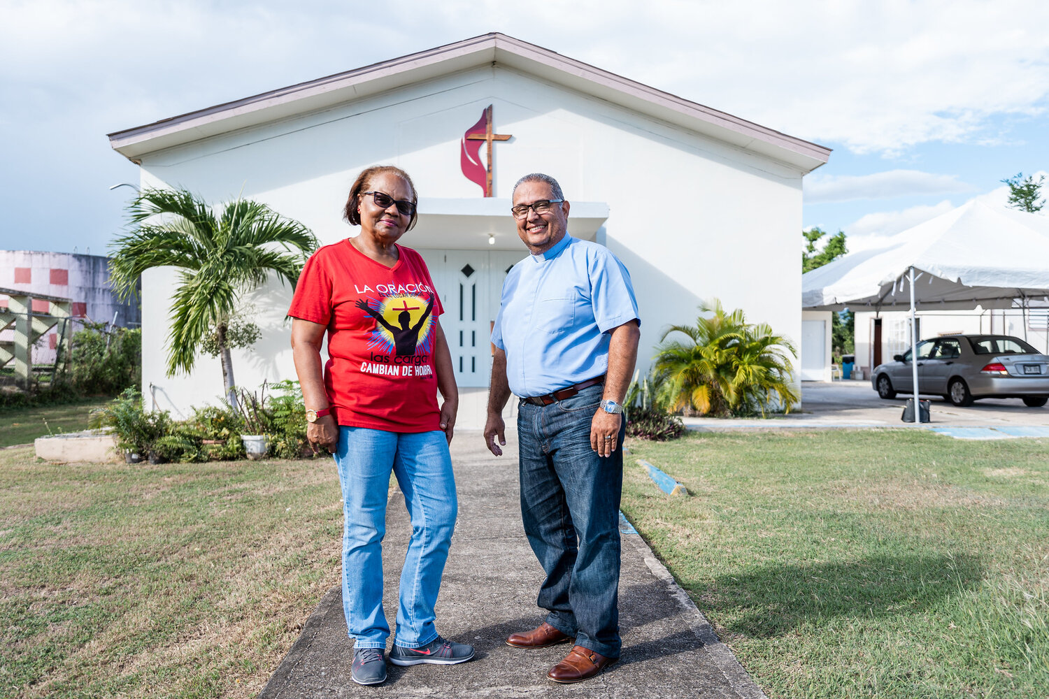 Pastor Hector Florez and Diaconal Minister Gloria Santiago stand in front of the church they serve in Puerto Rico, Iglesia Metodista Mesón de Amor, which became a community lifeline after Hurricane Maria. Photo courtesy of the United Methodist Development Fund.