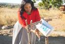 Rudo Sarah Mazamani, a United Methodist farmer in Headlands, Zimbabwe, uses a tippy-tap foot pedal device to wash her hands. The hands-free device is more hygienic than a traditional water tap. Photo by Kudzai Chingwe, UM News.