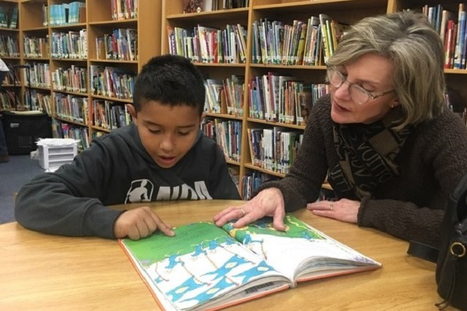 Mentor Susan Idleman (right), from First United Methodist Church Fort Worth's Kids Hope Mentoring ministry, reads with Johan (left), a fourth grader. The two meet weekly at Johan's school. Photo courtesy of Gay Ingram.
