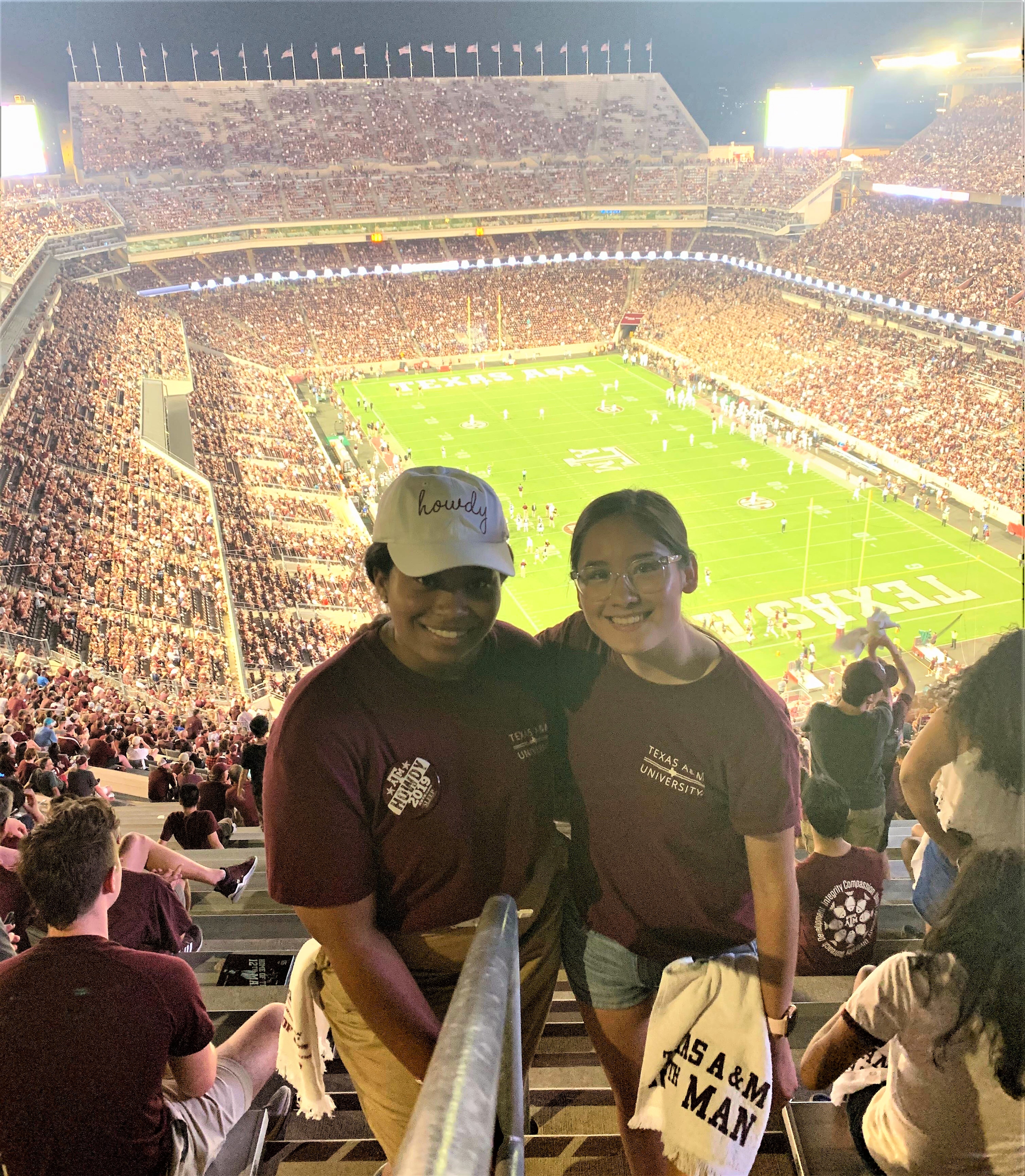 Angie (right) attends a football game at Texas A&M University at College Station, where she is a sophomore. Photo courtesy of Gay Ingram.
