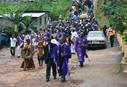 Bishop John K. Yambasu and clergy from the Sierra Leone Council of Churches lead a procession of worshippers to an area at the bottom of Mount Sugar Loaf where hundreds of bodies that were not recovered are still buried under the rubble of a devastating landslide. A service of remembrance and thanksgiving for the victims and survivors was held at the bottom of Mount Sugar Loaf, Aug. 27, 2017. File photo by Phileas Jusu, UM News.