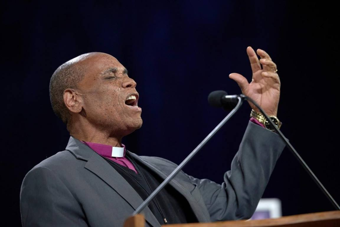 Bishop Eben K. Nhiwatiwa prays during the February 23, 2019, opening session of the Special Session of the General Conference of The United Methodist Church.  (Photo by Paul Jeffrey, UMNS.)