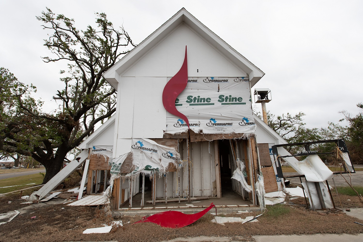 The United Methodist Cross and Flame logo lies in pieces after Hurricane Laura tore through Wakefield United Methodist Church in Cameron, La. Photo by Mike DuBose, UM News.