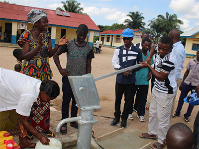 Residents of the communities surrounding the Dingele Health Center celebrate fresh, safe and potable water from their new well. Photo: Central Congo Health Board