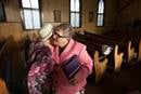 The Rev. Judy Flynn (right) welcomes Carmon Yeager to the Easter Sunday service at Bethel United Methodist Church in Junior, W.Va. File photo by Mike DuBose, UMNS.