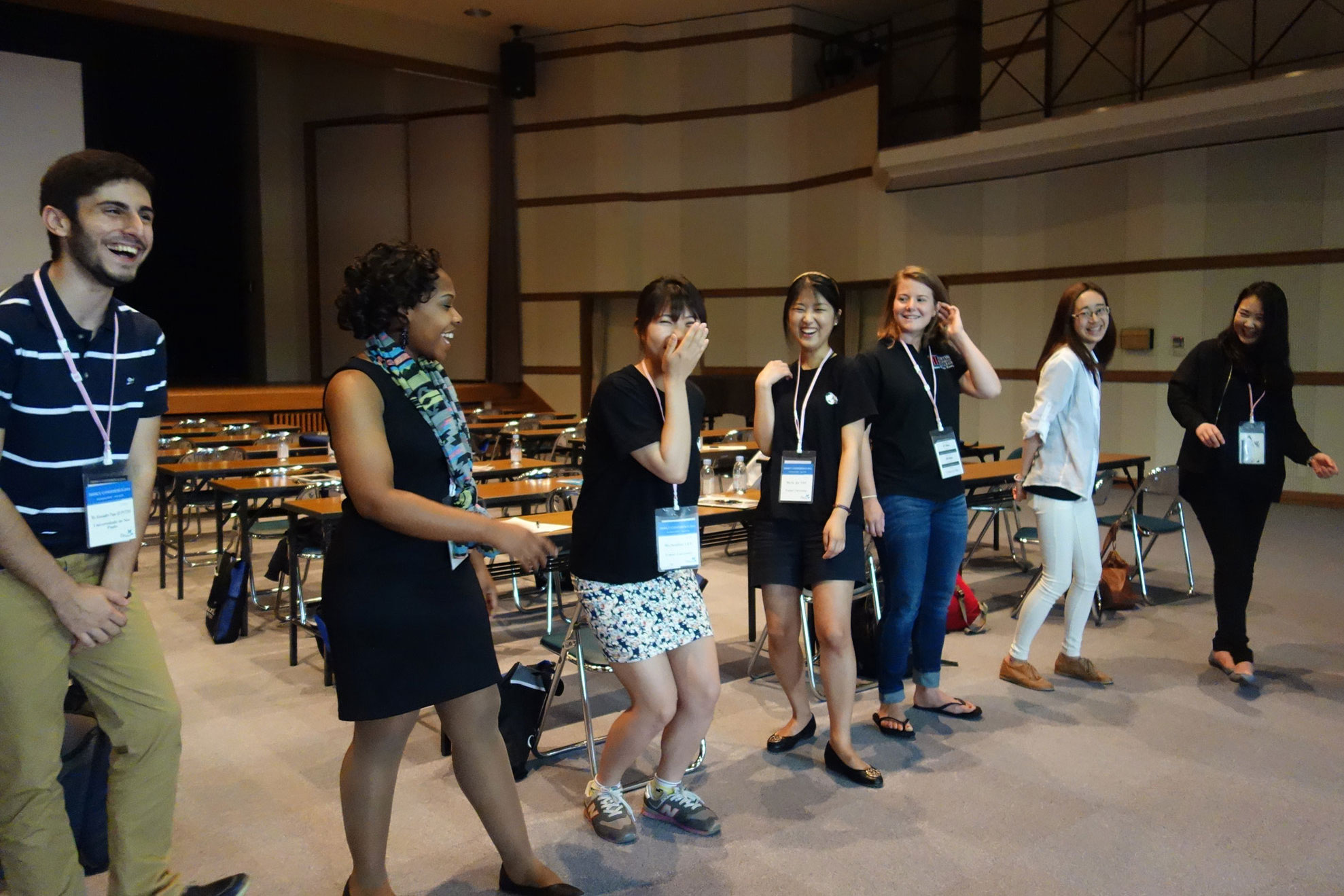 "Students attending the triennual IAMSCU Conference pass an imaginary ""energy ball"" during a workshop at Hiroshima Jagakuin University on May 27, 2014. File photo by Diane Degnan, United Methodist Communications."