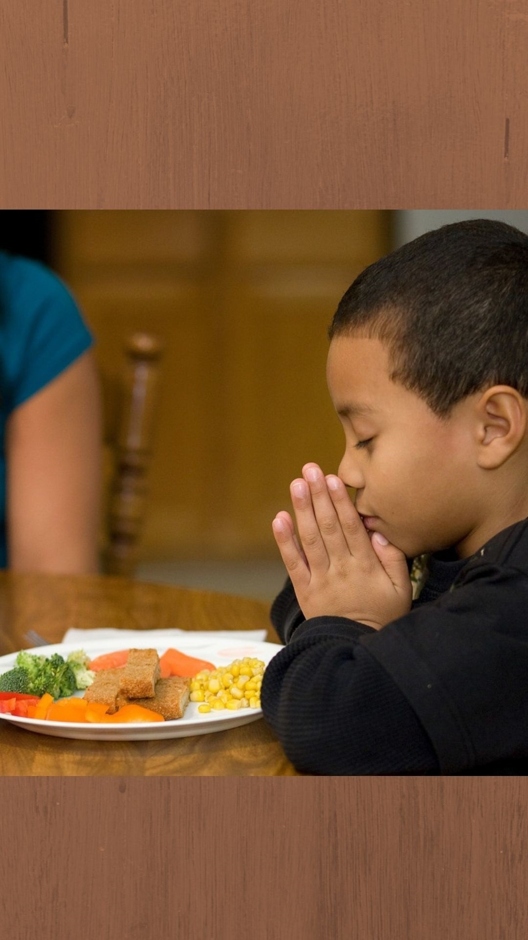 Geoffrey Booker, 6, prays before mealtime at his home in Brentwood, Tenn. Photo by Mike DuBose, UMNS [Adaption for UMC.org homepage hero]