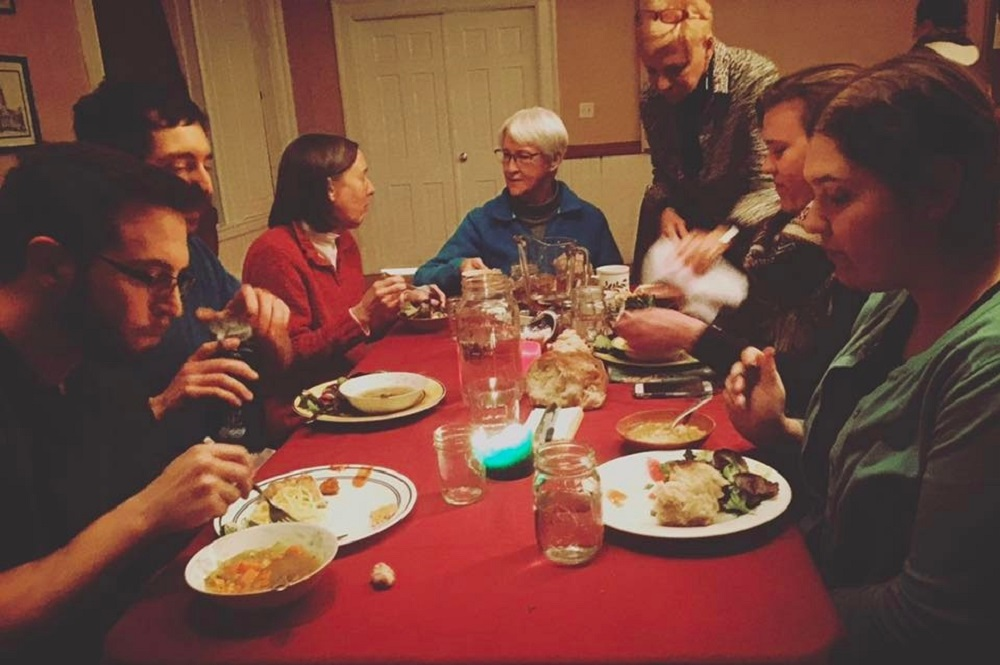 Gathering around the table to share a meal can be a form of worship, as pictured here in this 2017 photo at Simple Church in Grafton, Mass. Photo courtesy of Simple Church.