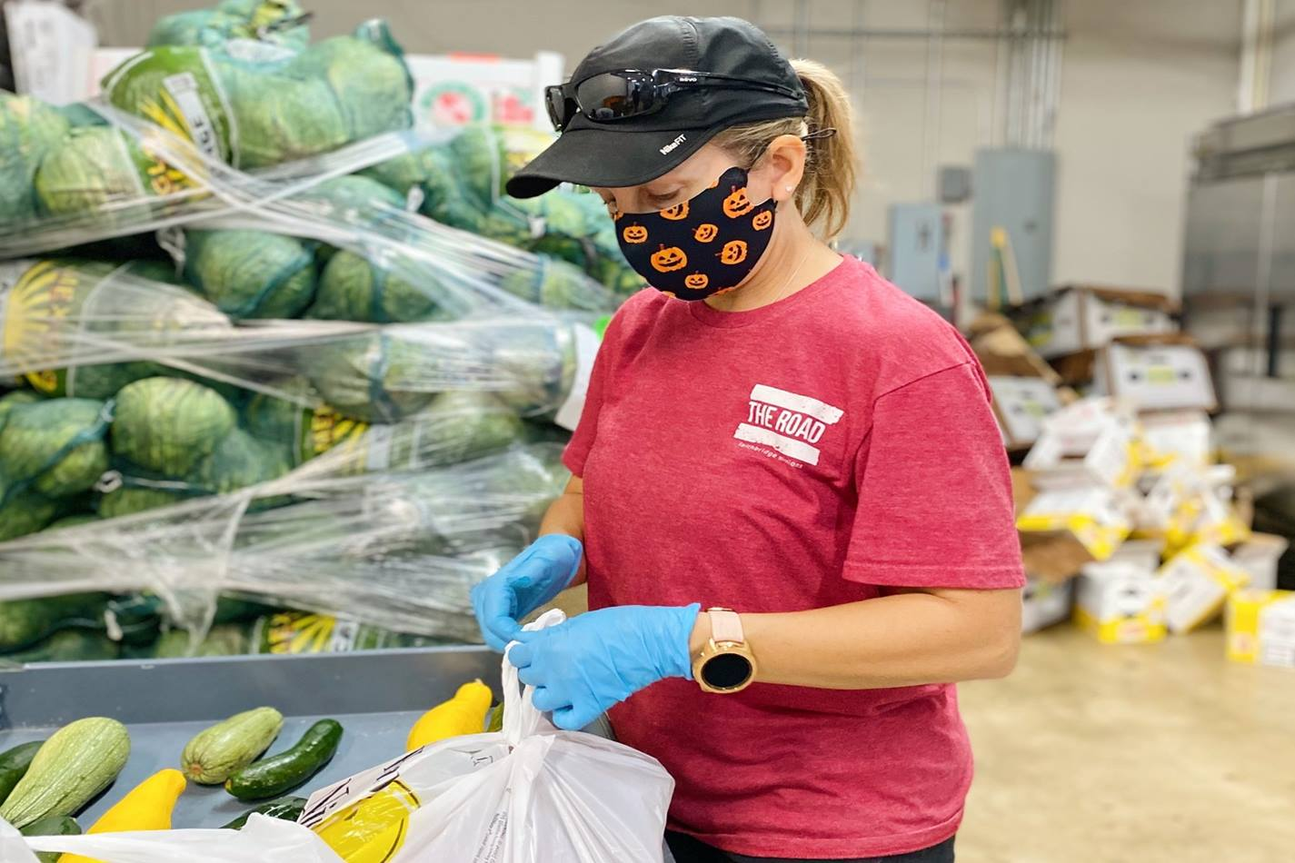 United Methodists, including Christy Sprague (pictured here), volunteer at Bridging For Tomorrow, a Houston community center, helping their neighbors, sometimes as many as 1,000 per week, receive food during the uncertainty of the pandemic.  Photo courtesy of Hannah Connor, Bridging For Tomorrow.