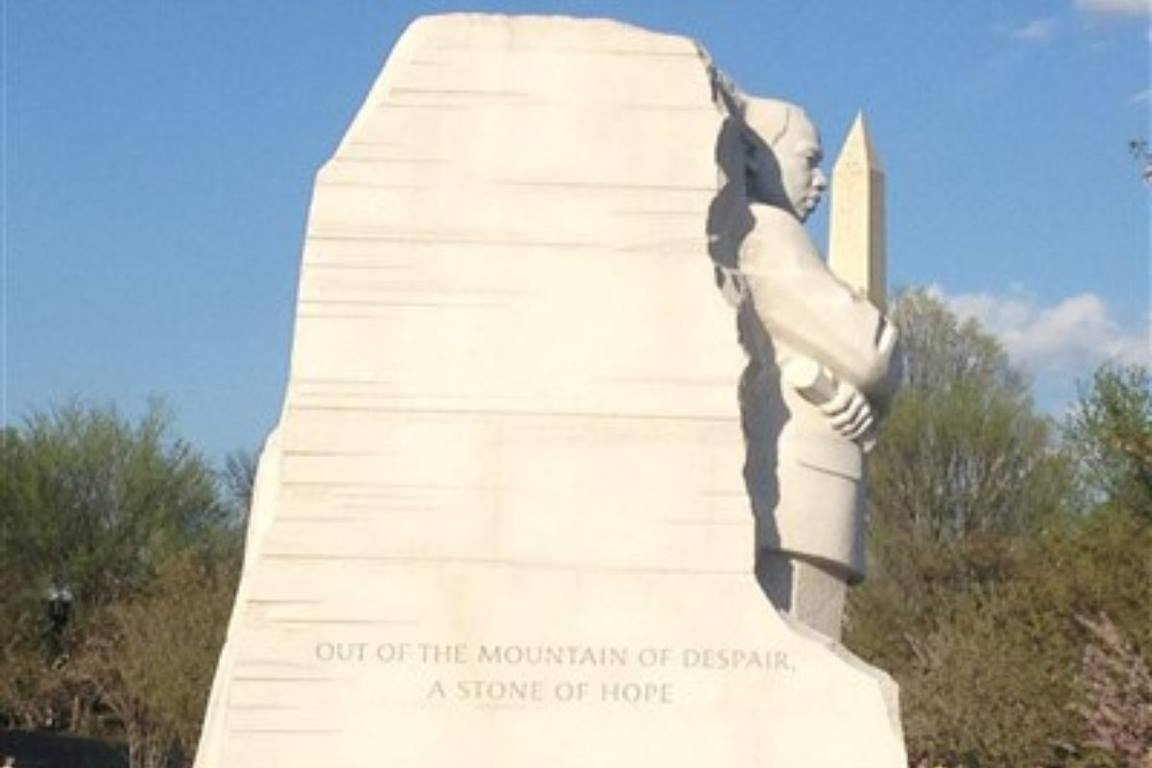 Martin Luther King Jr.'s Monument appears to cradle the Washington Monument in Washington, D.C. (Image by Maidstone Mulenga/Council of Bishops.)