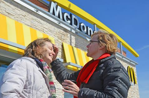 The Rev. Stephanie Vader of Emmanuel United Methodist Church in Scaggsville, Maryland, offers the imposition of ashes in a McDonald's parking lot. File photo from 2017 by Alison Burdett, Baltimore-Washington Conference.