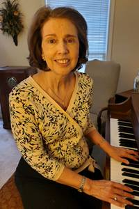 With her antique radio and piano nearby, Karen remembers the Methodist music that helped her make sense as a child of the Civil Rights movement in the sixties as well as the last year with anxiety about COVID, social justice marches and political unrest. Photo courtesy Karen Crenshaw Swenson.