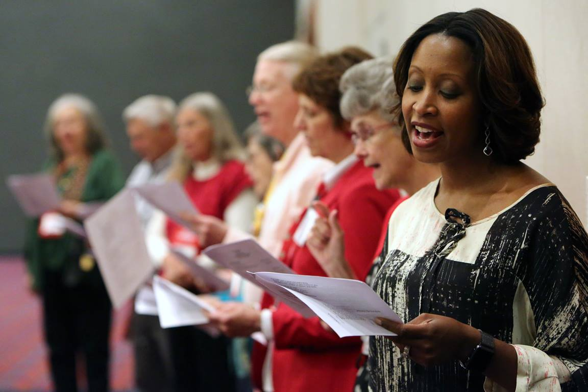 The Rev. Andrea Davidson sings during a communion service at the 2016 United Methodist General Conference in Portland, Oregon. Photo by Kathleen Barry, UMNS.