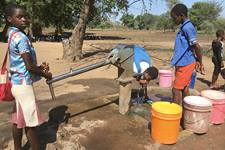 Schoolchildren drink from a borehole at Kalumba Primary School in Mangochi, Malawi, in September 2020. The borehole was drilled by the Malawi government. In response to water scarcity in this east African country, United Methodist Church of the Resurrection in Leawood, Kan., has helped fund the drilling of more than 80 boreholes since September. Photo by Francis Nkhoma, UM News.