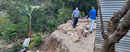 Maximo (left) inspects what is left of his house on a hillside in Cunen, Guatemala. A landslide caused by Hurricane Iota in November left little behind, but his family got out safely. PHOTO: COURTESY IENMPG