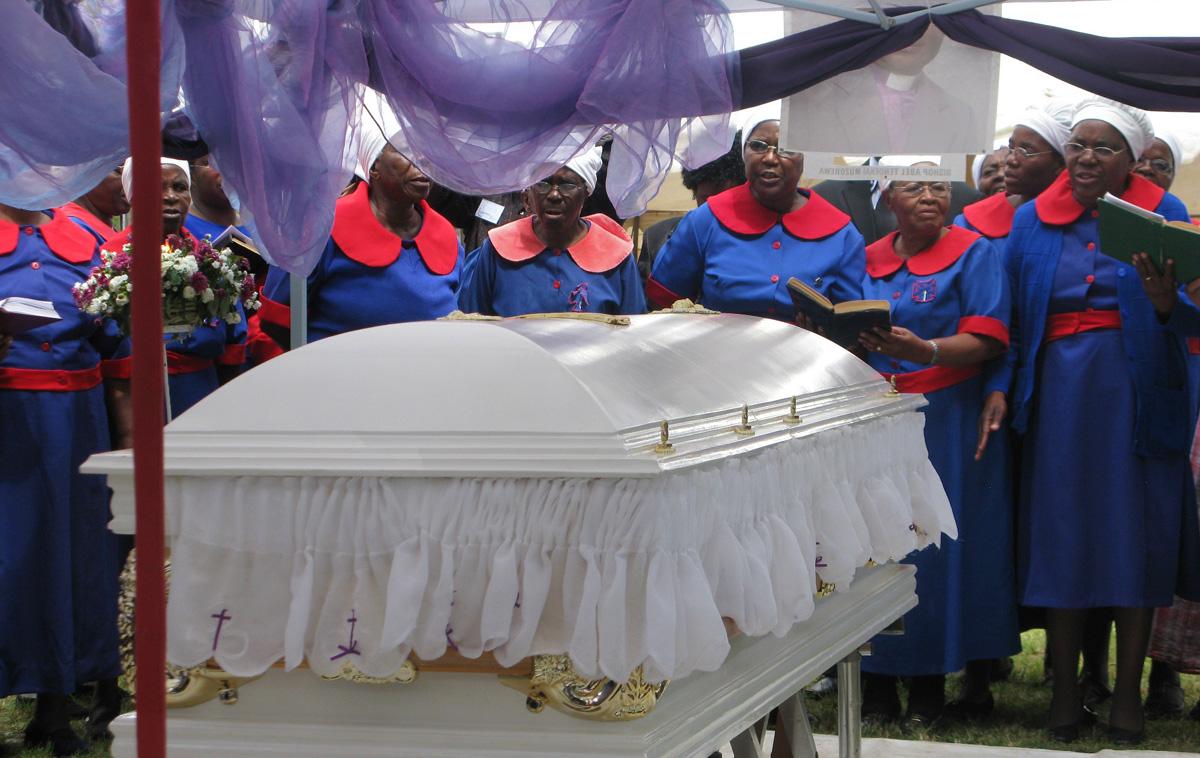 Women gather near the casket of United Methodist Bishop Abel T. Muzorewa in Mutare, Zimbabwe, in May of 2010. Some 5,000 people attended Bishop Muzorewa's funeral. Photo by Tafadzwa Mudambanuki, UM News.
