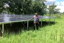 UMCOR's training officer gives a tour of the solar system at a farm in Kamina, Democratic Republic of Congo. Photo by Lorraine Charinda.