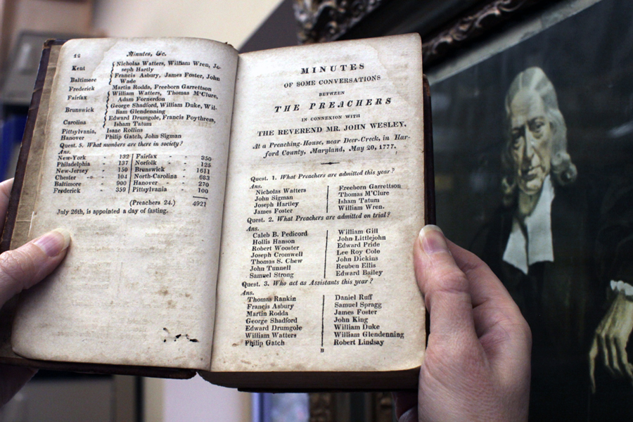Frances Lyons-Bristol, an archivist-records administrator for the General Commission on Archives and History, holds a book listing early Methodists, including the circuit rider, the Rev. Freeborn Garrettson. Photo by Kathleen Barry, United Methodist Communications.