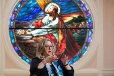 "Kellie D. Brown is the author of ""The Sound of Hope: Music as Solace, Resistance and Salvation During the Holocaust and World War II."" She discusses the book while seated in front of a stained-glass depiction of Jesus at First Broad Street United Methodist Church in Kingsport, Tenn., where she is a member. Photo by Mike DuBose, UM News."