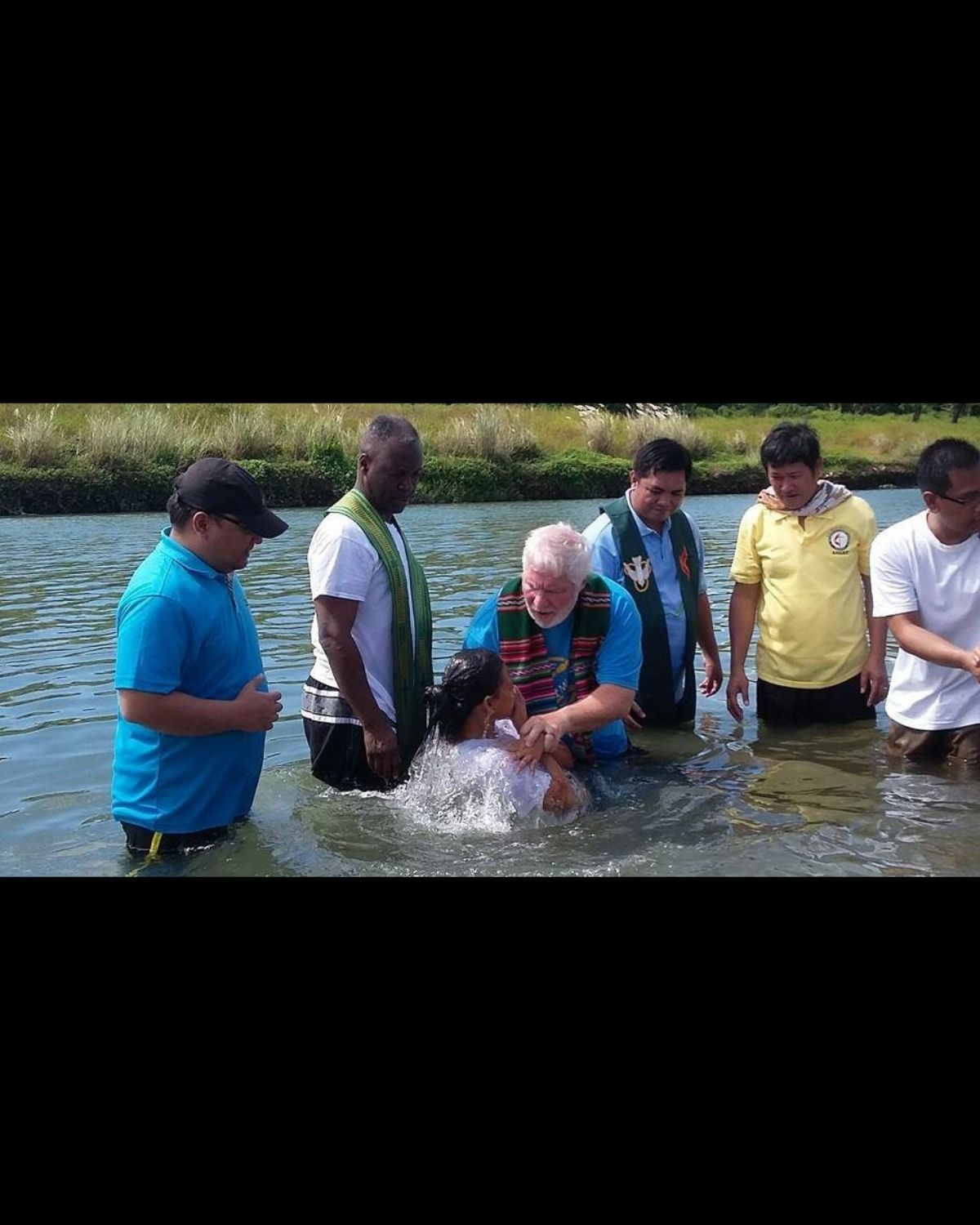 River baptism in Philippines. Photo by Rev. Joey Galinato. Canva design for UMC.org hero
