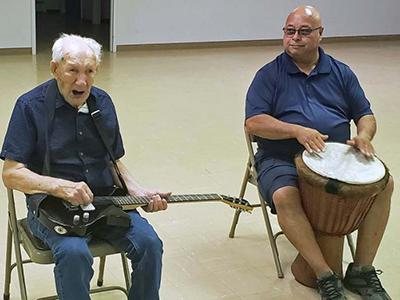 Al Weber plays the guitar.