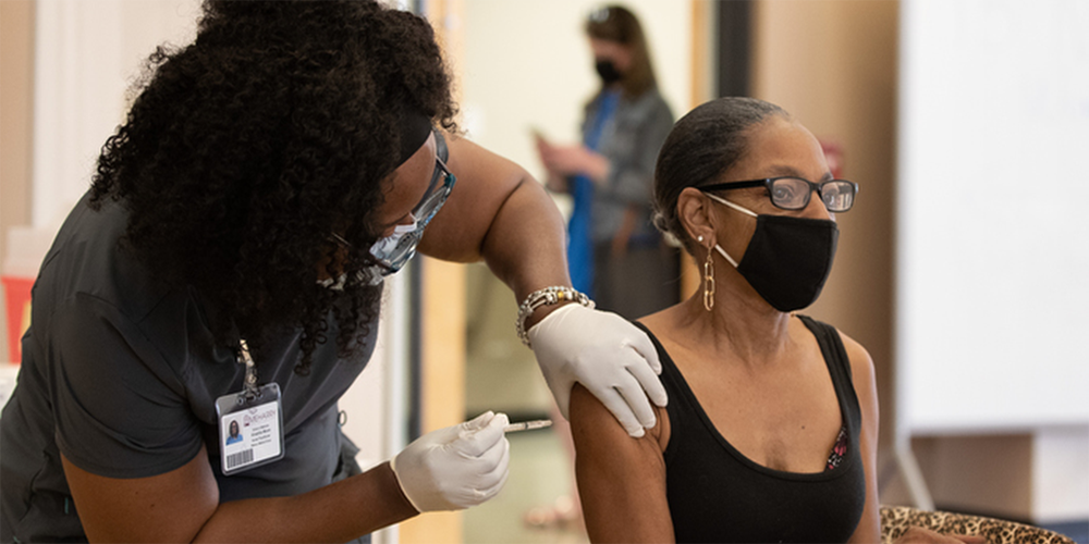 Joyce Holland receives a COVID-19 vaccination from Tia Moore, nurse practitioner, at Meharry Medical College in Nashville, Tenn.Photos by Mike DuBose