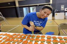 Meg Carter at Calvary United Methodist Church decorates peach cookies being sold to pay for a new church air conditioner. Photo courtesy of Calvary United Methodist Church.