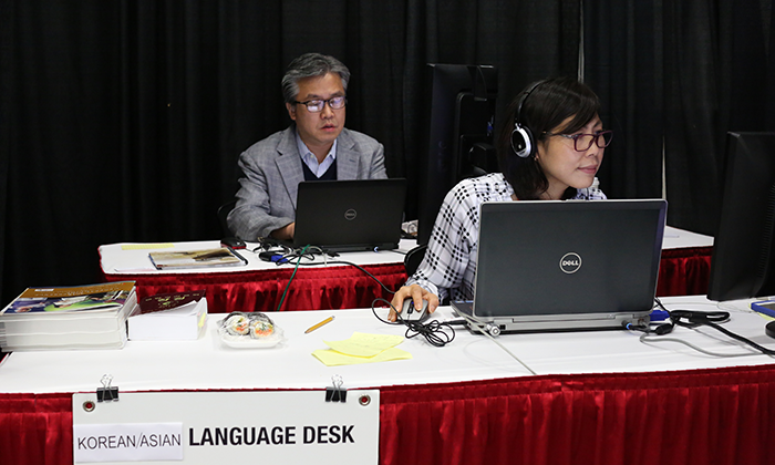 (From left) The Rev. Jacob Lee and Joo Kim work the Korean/Asian-language desk during the 2016 United Methodist General Conference in Portland, Ore. Photo by Kathleen Barry, United Methodist Communications Kathleen Barry