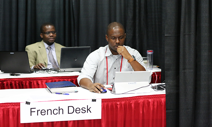 Isaac Broune and Joe Tueche Ndzulo handle the French desk during the 2016 United Methodist General Conference in Portland, Ore. Photo by Kathleen Barry, United Methodist Communications Kathleen Barry