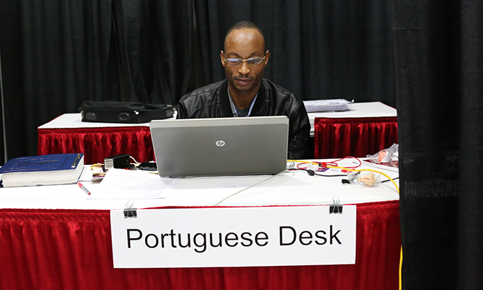 Nafral Oliveria Massela Nafral, conference communicator for Mozambique, works on the Portuguese desk during the 2016 United Methodist General Conference in Portland, Ore. Photo by Kathleen Barry, United Methodist Communications Kathleen Barry