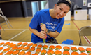 Meg Carter decorating cookies for the peach festival. Courtesy photo.