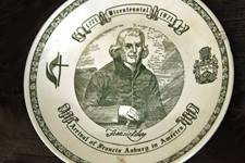 A commemorative plate on display inside the boyhood cottage of Bishop Francis Asbury celebrates the 1971 bicentennial of his journey to America. 2021 is the 250th anniversary of Asbury's crossing. Photo by Kathleen Barry, United Methodist Communications.
