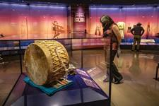 Visitors browse a gallery of artifacts at the First Americans Museum in Oklahoma City. The museum held its grand opening on Sept. 18-19. It took decades to get funding and build the museum. Photo courtesy of First Americans Museum.